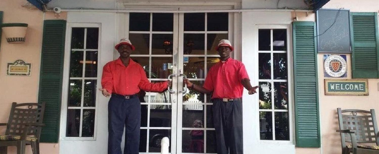 Entrance of hotel with attendants at the doors